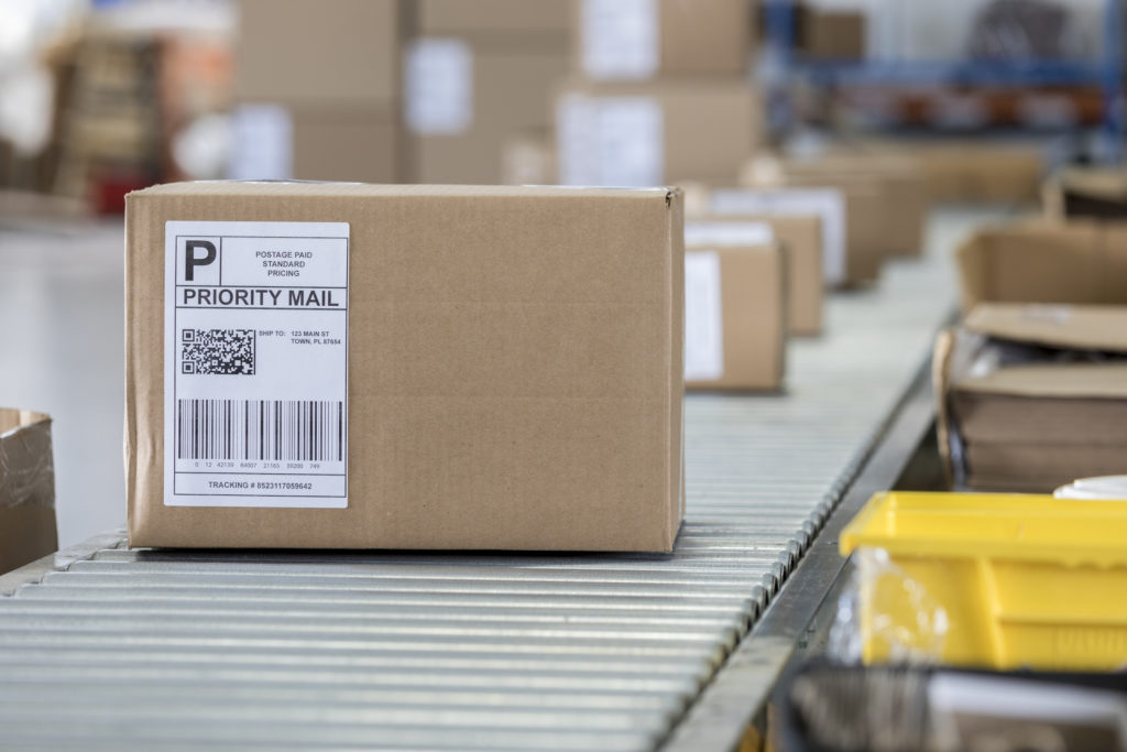 Package ready to be shipped going down a packing line in distribution center