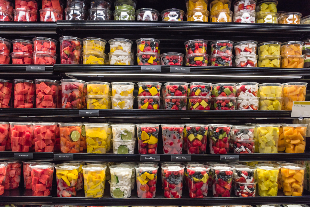 shelves lined with packaged fruit